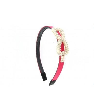 cerchietto per capelli con fiocco di perle colore fucsia